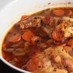 rabbit stew in white casserole dish