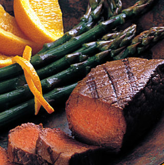 OSTRICH STEAK WITH ASPARAGUS ON A PLATE