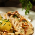 Pheasant in almond sauce with mushrooms and potatoes